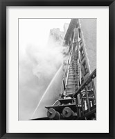 Framed Fire engine with ladder up burning building
