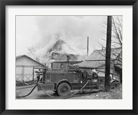Framed Fire engine next to home in fire