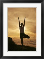 Framed Silhouette of a young woman exercising, Haleakala National Park, Maui, Hawaii, USA