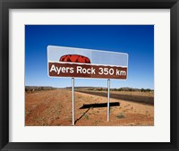 Framed Distance sign on the road side, Ayers Rock, Uluru-Kata Tjuta National Park, Australia