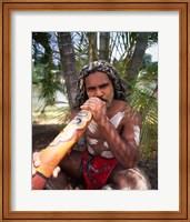 Framed Pamagirri aborigine playing a didgeridoo, Australia