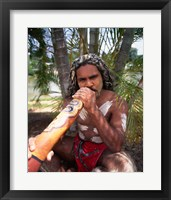 Framed Pamagirri aborigine playing a didgeridoo, Australia