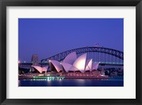 Framed Opera house lit up at dusk, Sydney Opera House, Sydney Harbor Bridge, Sydney, Australia