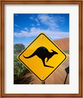 Framed Kangaroo sign on a road with a rock formation in the background, Ayers Rock