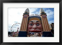 Framed Low angle view of the entrance to an amusement park, Luna Park, Sydney, New South Wales, Australia