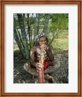 Framed Aborigine playing a didgeridoo, Cairns, Queensland, Australia