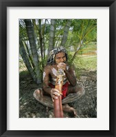 Framed Aborigine playing a didgeridoo, Cairns, Queensland, Australia