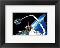 Framed Shuttle discovery Satelite deployment