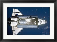 Framed STS-135 Atlantis approaches the ISS