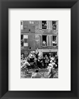 Framed People watching the cyclists being provisioned. Tour de France 1958.