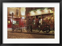 Framed Bicycles parked in front of a restaurant at night, Dublin, Ireland
