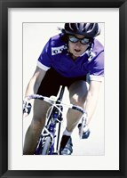 Young woman riding a bicycle Framed Print