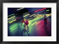 Framed Young man riding a bicycle