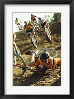 Framed Young man falling off his bicycle in a race