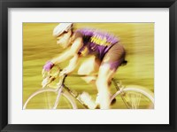 Framed Side profile of a young man cycling