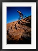 Low angle view of a man mountain biking, Utah, USA Framed Print