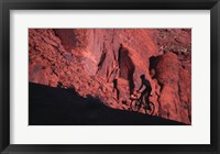 Framed Silhouette of a man mountain biking, Moab, Utah, USA