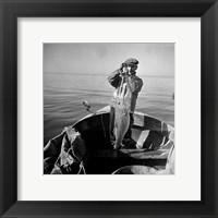 Framed Hauling in a cod aboard a Portuguese fishing dory off Cape Cod, Massachusetts