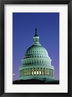 Framed Capitol Building lit up at night, Washington D.C., USA