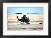 Framed AH-1 Cobra helicopter