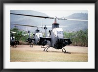 Framed Three AH-1 Cobra gunship helicopters