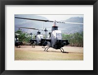 Framed Three AH-1 Cobra gunship helicopters