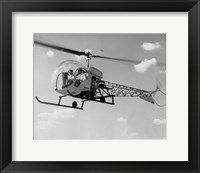 Framed Low angle view of two people sitting in a helicopter, Bell 47G-2