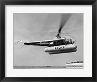 Framed Low angle view of a helicopter in flight, Bell 47-D, Bell Aircraft Corporation