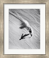 Framed High angle view of a man skiing downhill