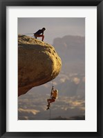 Framed View of rock climbers on the edge of a cliff