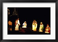 Framed Figurines depicting nativity scene lit up at night