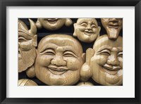 Framed Close-up of Faces of Laughing Buddha, Vietnam