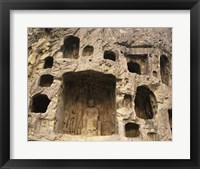 Buddha Statue Carved on a wall, Longmen Caves in China Framed Print