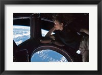 Framed Tracy Caldwell Dyson in the Cupola Observing the Earth during Expedition 24