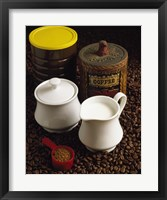 Framed Close-up of a mug of milk with a measuring spoon and jars on coffee beans