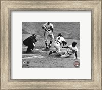 Framed Jackie Robinson steals home during the 1955 World Series