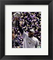 Framed Ray Lewis with the Vince Lombardi Trophy after winning Super Bowl XLVII