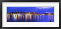 Framed Buildings at the waterfront lit up at dusk, Stockholm, Sweden