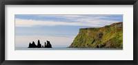 Framed Basalt rock formations in the sea, Vik, Iceland