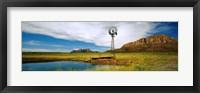 Framed Solitary windmill near a pond, U.S. Route 89, Utah