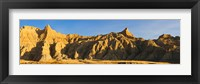 Framed Sculpted sandstone spires in golden light, Saddle Pass Trail, Badlands National Park, South Dakota, USA
