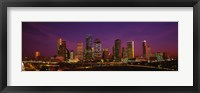 Framed Buildings lit up at night, Houston, Texas, USA