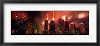 Framed Fireworks over buildings in a city, Houston, Texas