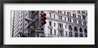 Framed Low angle view of a Red traffic light in front of a building, Wall Street, New York City
