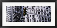 Framed Low angle view of a Green traffic light in front of a building, Wall Street, New York City