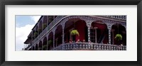 Framed People sitting in a balcony, French Quarter, New Orleans, Louisiana, USA