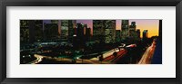 Framed Harbor Freeway and buildings lit up, Los Angeles CA