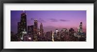 Framed Chicago Buildings lit up at dusk