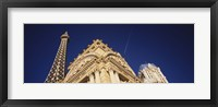 Framed Low angle view of a building in front of a replica of the Eiffel Tower, Paris Hotel, Las Vegas, Nevada, USA
