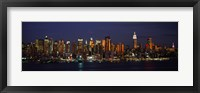 Framed Skyscrapers lit up at night in a city, Manhattan, New York City, New York State, USA
